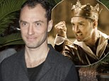 Jude Law celebrates after earning rave reviews for Henry V (but he won't be too happy about all those mentions of his receding hairline)