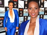 Alicia Keys cuts a striking figure in plunging bright blue suit as she steps out at Sydney music launch