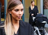 Kim Kardashian steps out with daughter North in New York just days after rubbishing reports she doesn't spend enough time with her baby
