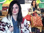 Thrifty fashionista! Stylish Rachel Bilson snaps up a bag full of cut price clothes from discount department store T.J. Maxx