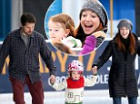 Sugar and spice...and everything ice! Alyson Hannigan and husband Alexis Denisof take daughter Satyana for her first spin around the ice skating rink