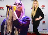 She's still a sk8er girl! Avril Lavigne dons leather pants and heavily smudged black eyeliner as she takes to the stage at the Q102 Jingle Ball