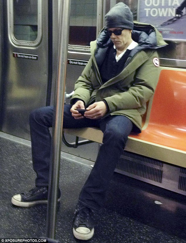 Easy traveller: Kevin Bacon proved just how down to earth he was by catching the subway around New York City with a carriage of commuters on Thursday