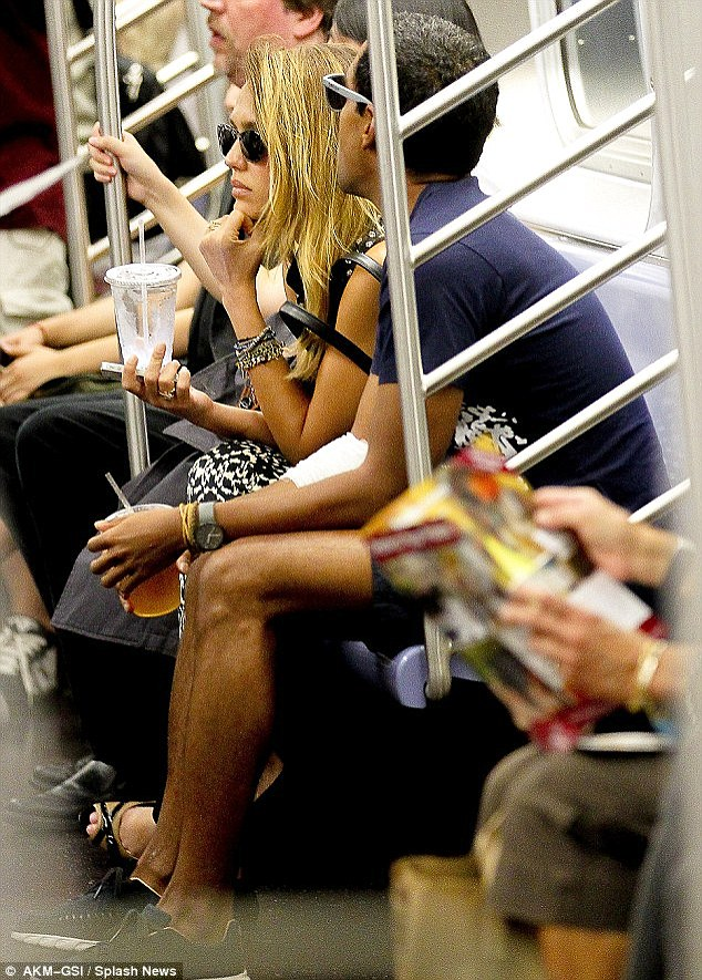 Rolling with it: Jessica Alba and her husband Cash Warren were snapped on the subway together earlier this year