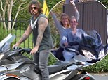 Like daughter, like father! Billy Ray Cyrus goes for a spin on his Can Am Spyder just like the one he bought Miley