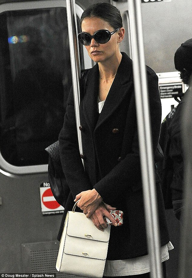 Going incognito: Katie Holmes covered up in huge shades as she hit the subway earlier this year