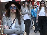 That's not like you! Kendall Jenner self-consciously crosses her arms as she hits the mall with sister Kylie