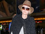 Hats off to her: The star looks perfectly chic as she jets off to Paris, France