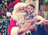 Snap happy! Melissa Joan Hart spreads some holiday cheer as she gets in the Christmas spirit