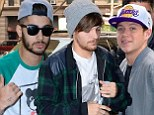 Cheer up, you've made chart history! One Direction arrive for SNL rehearsals as new album hits number one spot... but only Niall's smiling