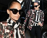 That's how to mix prints! Nicole Richie stylishly combines a striped shirt and floral bomber to take off from Los Angeles International Airport on Wednesday