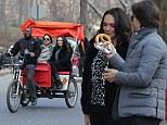 New York cravings! Pregnant Tamara Ecclestone indulges in a hotdog after enjoying romantic rickshaw ride with husband Jay Rutland