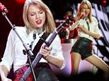 Taylor Swift shows off her long legs and guitar skills as she performs Down Under in high-waisted leather hotpants