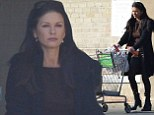 Shopping for one: Catherine Zeta-Jones looks subdued on solo supermarket trip amid rumours she's reunited with Michael Douglas