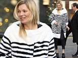 Kate Moss recycles her favourite monochrome striped fur coat as she squeezes in a spot of Christmas shopping