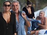 Let me get that! Roberto Cavalli's younger girlfriend Lina Nilson acted like his caretaker too as the two beached in Miami on Thursday