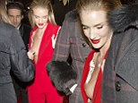 Rosie Huntington-Whiteley left red-faced as fan points out her gaping jacket has left her breast entirely exposed