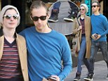 His and hers! Anne Hathaway and husband Adam Shulman wear matching funky sneakers as they walk arm in arm after a coffee date