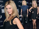 Doing their country proud! Joanna Krupa bares her legs in flared skirt while Anja Rubik goes for grunge at fashion show in Poland