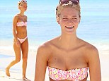 She's a natural! Make-up free Erin Heatherton flaunts flawless figure in pink bikini as she takes ocean dip in Barbados