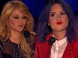 Making a decision: Demi Lovato and her fellow judges had to eliminate two acts on Thursday night on The X Factor
