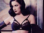 So Erotique! Dita Von Teese showcases her burlesque body in bondage-style black lingerie and black leather gloves in a new video to promote her fourth fragrance Erotique