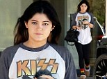 She's with the band: Kylie Jenner leaves a salon bare-faced in an over-sized Kiss t-shirt... and her fluffy slippers