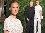 Lovely in lace: Bar Refaeli pulls off an outfit unbecoming on most as she adds some flare to designer Michael Kors' Milan boutique opening