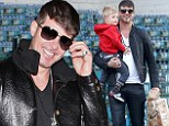 Get a moo-ve on: Leather-clad Robin Thicke pulled a cheesy pose after jetting into Los Angeles on Thursday