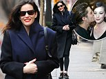 Liv Tyler steps out stylish and smiling... day after denying reports she is 'secretly dating' Lord Of The Rings co-star Orlando Bloom