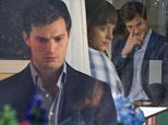 No smiling allowed! Jamie Dornan breaks character as Christian Grey by cracking a grin while filming Fifty Shades Of Grey with Dakota Johnson