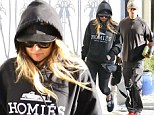 Hiding her Humps! Fergie covers up her lovely lady lumps with hooded top on outing with husband Josh Duhamel