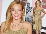 Loud and proud: Lindsay Lohan made a bold statement by arriving in a glittering gold dress to the Art Basel: Art of Bullfighting event in Miami, Florida on Thursday