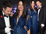 That's my baby! David Arquette points to his girlfriend Christina McLarty's pregnant belly at Hollywood Lawn event