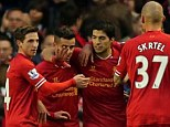 Getting the show on the road: Luis Suarez (second right) saw his shot saved then go in off of Guy Demel