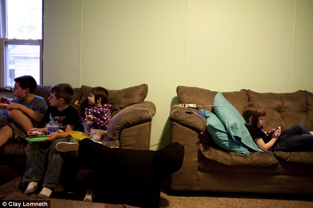 As her siblings and a friend watch a movie Michaelynn plays on her own