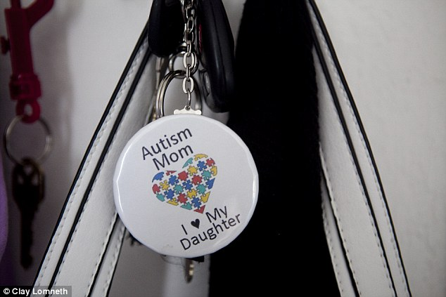 Erica Sanchez has a button hanging from her purse declaring her love for her autistic daughter