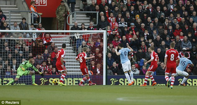 Red hot form: Sergio Aguero (right) gives City an early lead at St Mary's