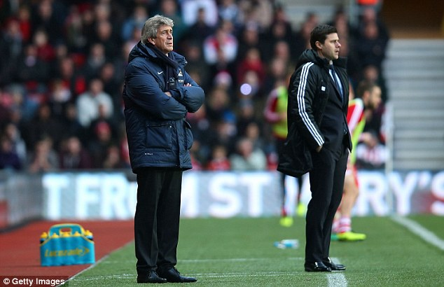 Watching on: Managers Manuel Pellegrini (left) and Mauricio Pochettino (right) observe from their technical areas