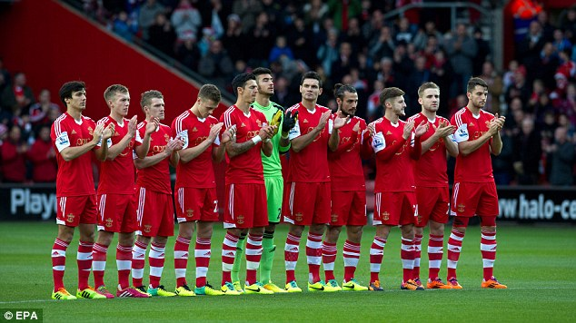 Respect: The players applaud the memory of Nelson Mandela before kick-off