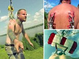 Extreme base jumpers attach metal hooks on harness to their SKIN before jumping 250feet off platform