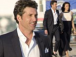 It's a tough job! Patrick Dempsey escorts lovely co-star as they get ready to shoot on the beach in Los Angeles