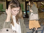 Make-up free Mischa Barton drowns her figure in frumpy outfit as she takes her pooches to the dog groomer