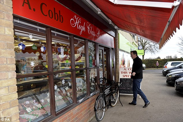 A chillaxed Saturday: Prime Minister David Cameron visited family butchers, A Cobb, in Aylesbury, Buckinghamshire, to mark 'Small Business Saturday'