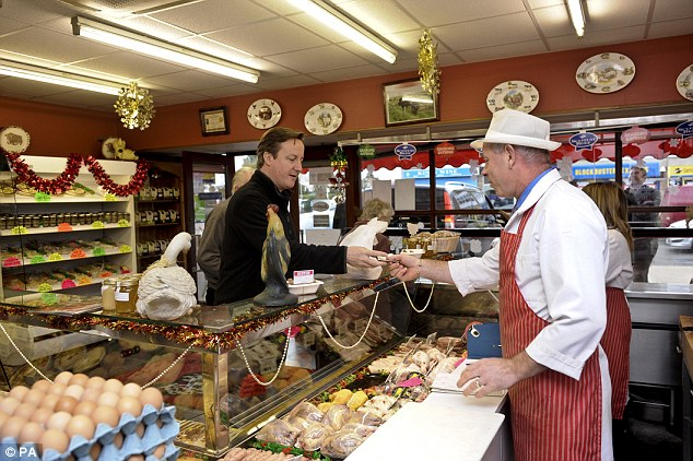 Local produce: Mr Cameron visited A Cobb butchers in Aylesbury, Buckinghamshire, ahead of his mother Mary's visit to Chequers for dinner on Saturday night