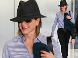 Fabulous at 44: Jennifer Aniston maintains her youthful glow with a trip to a skin care clinic before covering up from the harsh Californian sun