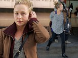 Baby it's cold outside! Bare-faced Hayden Panettiere shrugs on her coat as she jets in to London from sunny LA