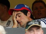 Can't bear to watch: England captain Alastair Cook (right) shuts his eyes across from coach Andy Flower