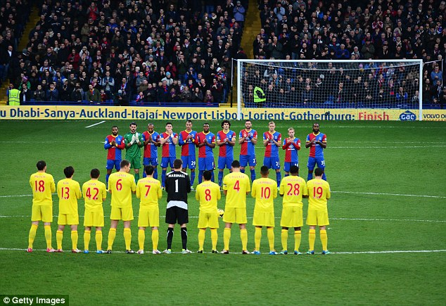 Madiba: Players and fans take part in the minutes applause to honour the recently departed Nelson Mandela