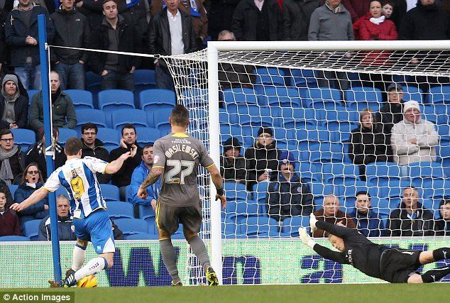Strike: Ashley Barnes scores Brighton's first goal against Leicester